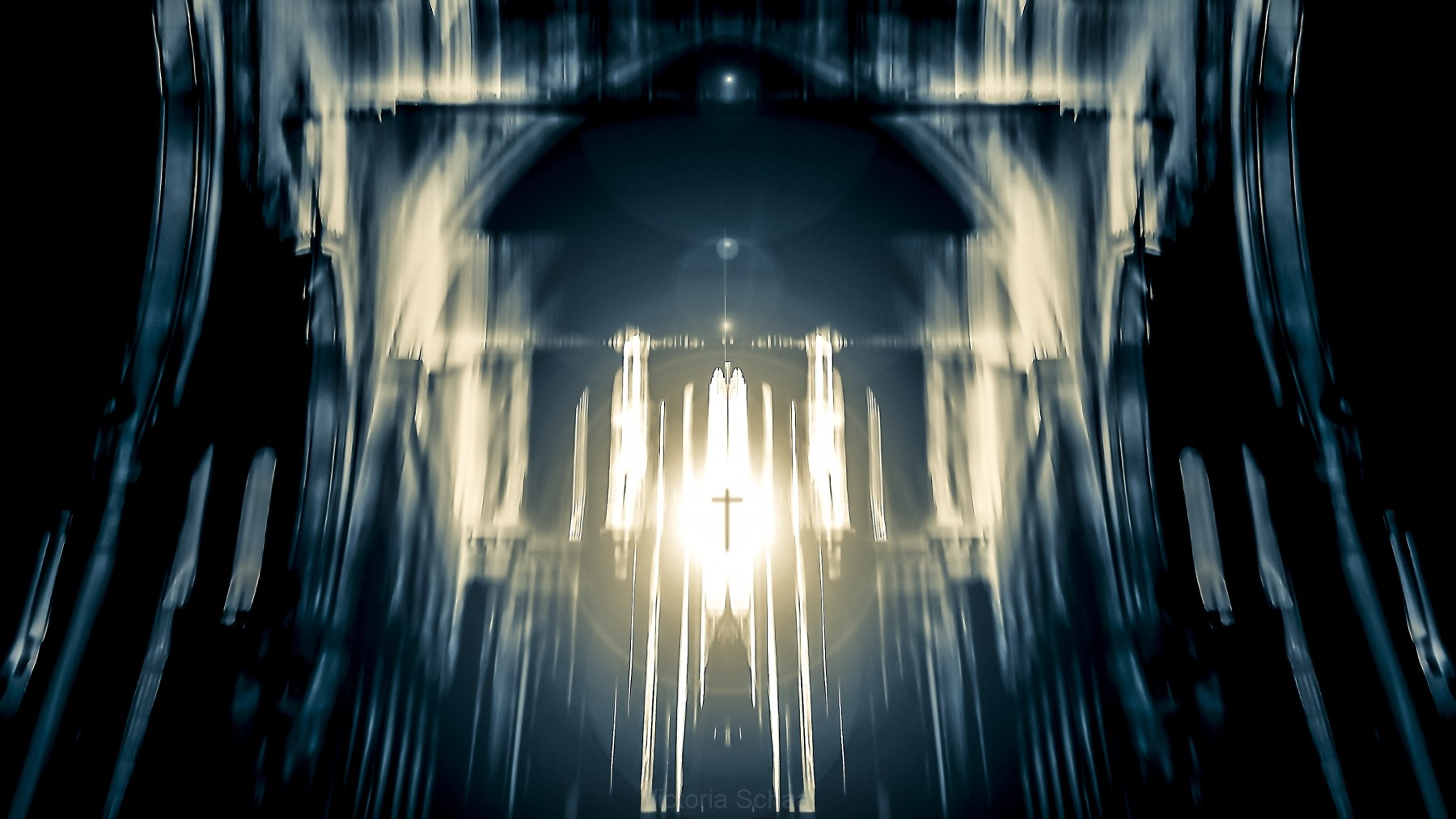 Symbolic image of Christian cross emerging in light from the window of a church