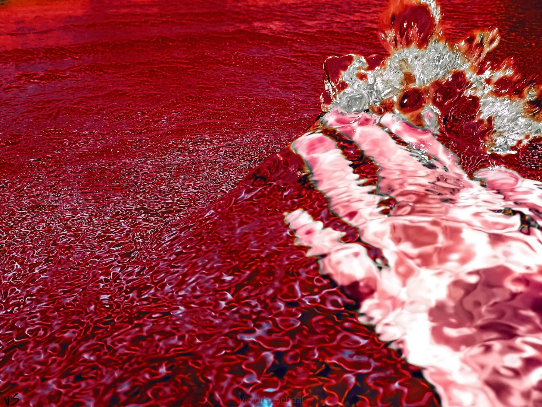 Hand under splash of blood and water