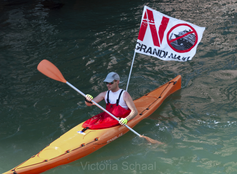 Protester against cruise ships in Venice on kayak in lagoon