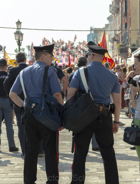 Two carabinieri in front of protesters against cruise ships in Venice